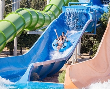 Fasouri Watermania Waterpark was launched in 1999 and developed in a way to blend naturally with the beautiful environs of a 105,000 square metres citrus grove and landscaped gardens. The water park which boasts a Polynesian theme is presently the biggest water park in Cyprus both in size and number of attractions and facilities. It is the ideal place for families, friends and children and promises a fun-filled outing away from work troubles and paper loads. The waterpark closes only due to bad
